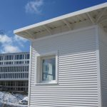 Pförtnercontainer Fassade gewellt